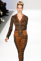 Fanny Francois walks the runway in a Luca Luca Fall 2011 outfit, designed by Raul Melgoza, during Mercedez-Benz Fashion Week, February 10, 2011