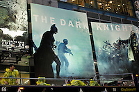 People pass next to posters of 'Dark Knight Rises' movie premier after NYPD increased security at movie theaters in New York, July 20, 2012.  Photo by Eduardo Munoz Alvarez / VIEW.