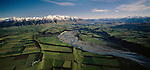 Aerial of the Rakaia River, Mount Hutt, and the Canterbury Plains. Patchwork of crops and green fields. Canterbury Region. New Zealand.