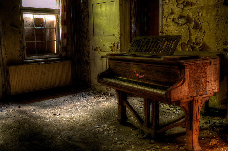 Sunlight shining onto old piano. Found in a abandoned sanatorium near Berlin. East Germany