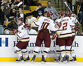 Pat Mullane (BC - 11), Jimmy Hayes (BC - 10), Brian Dumoulin (BC - 2), (Cross, KHayes) - The Boston College Eagles defeated the Northeastern University Huskies 5-4 in their Hockey East Semi-Final on Friday, March 18, 2011, at TD Garden in Boston, Massachusetts.