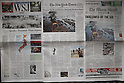 March 13, 2011, Florida, USA - The front pages of some U.S. newspapers, left to right, The Wall Street Journal, The New York Times and The Miami Herald, reporting Japan's massive earthquake in Doral, Florida, on Sunday, March 13, 2011. The biggest earthquake on record struck the Tohoku region coast on Friday. (Photo by Thomas Anderson/AFLO) [0903] **JAPANESE NEWSPAPER OUT**.