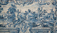 Hunting scene, traditional blue and white azulejos tile scene, 18th century, part of a series depicting the history of the monastery and the Siege of Lisbon in 1147, in the Monastery of Sao Vicente de Fora, an Augustinian order monastery and church built in the 17th century in Mannerist style, Lisbon, Portugal. The monastery also contains the royal pantheon of the Braganza monarchs of Portugal. Picture by Manuel Cohen