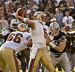 San Francisco 49ers quarterback Jeff Garcia (5) passes down the field on Sunday, November 3, 2002, in Oakland, California. The 49ers defeated the Raiders 23-20 in an overtime game.