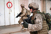 U.S. Marines from India Company, 3rd Battalion, 3rd Marine Regiment conduct a patrol in Haditha, Iraq, Aug. 7, 2006. (U.S. Marine Corps photo by Cpl. Brian M. Henner) (Released)