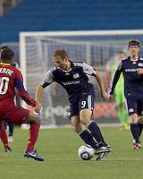 New England Revolution forward Ilija Stolica (9) dribbles. In a Major League Soccer (MLS) match, Real Salt Lake defeated the New England Revolution, 2-0, at Gillette Stadium on April 9, 2011.