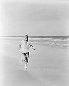 Astronaut John H. Glenn Jr., pilot of the Mercury-Atlas 6 mission, participates in a strict physical training program, as he exemplifies by frequent running.  Photo taken in 1962..Credit: NASA via CNP