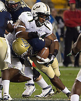 USF defensive end Patrick Hampton (41) tackles Pitt running back Ray Graham (1).The Pitt Panthers defeated the USF Bulls 44-17 on September 29, 2011 at Heinz Field in Pittsburgh Pennsylvania.