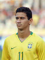 Brazil's Paulo Henrique (11) stands on the field before the match against Germany during the FIFA Under 20 World Cup Quarter-final match at the Cairo International Stadium in Cairo, Egypt, on October 10, 2009. Germany lost 2-1 in overtime play.