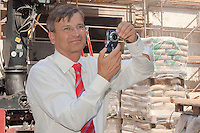 Budapest city mayor Gabor Demszky takes photos with his digital camera during a city reconstruction press walk in the city City centre, Budapest, Hungary. Friday, 14. July 2006. ATTILA VOLGYI