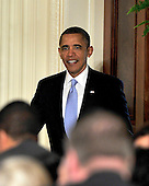 United States President Barack Obama enters the East Room of the White House in Washington, D.C. prior to making remarks calling on Congress to return powers that would allow him to reform Executive Branch agencies of the U.S. Government on Friday, January 13, 2012..Credit: Ron Sachs / CNP