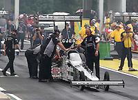 May 17, 2015; Commerce, GA, USA; Crew members make final preparations for NHRA top fuel driver Larry Dixon during the Southern Nationals at Atlanta Dragway. Mandatory Credit: Mark J. Rebilas-USA TODAY Sports