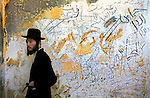 A man during an evening prayer inside an abandoned Egyptian house, as ultra-orthodox Jewish men visit the Israeli outpost of Shirat Hayam, in the settlement bloc of Gush Katif, Gaza Strip. A growing number of ultra-orthodox Jews support the settlers' struggle against the planned pullout from Gaza.