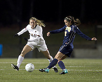 """West Virginia defender Meghan Lewis (12) passes as Boston College forward Stephanie Wirth (22) defends. Boston College defeated West Virginia, 4-0, in NCAA tournament """"Sweet 16"""" match at Newton Soccer Field, Newton, MA."""