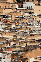 General view of Medina rooftops, Fez, Morocco, pictured on February 22, 2009 in the morning. Fez, Morocco's second largest city, and one of the four imperial cities, was founded in 789 by Idris I on the banks of the River Fez. The oldest university in the world is here and the city is still the Moroccan cultural and spiritual centre. Fez has three sectors: the oldest part, the walled city of Fes-el-Bali, houses Morocco's largest medina and is a UNESCO World Heritage Site;  Fes-el-Jedid was founded in 1244 as a new capital by the Merenid dynasty, and contains the Mellah, or Jewish quarter; Ville Nouvelle was built by the French who took over most of Morocco in 1912 and transferred the capital to Rabat. Picture by Manuel Cohen.