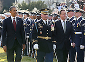 U.S. President Barack Obama (L)  welcomes British Prime Minister David Cameron during an official arrival ceremony at the South Lawn of the White House March 14, 2012 in Washington, DC. Prime Minister Cameron was on a three-day visit in the U.S. and he was expected to have talks with President Obama on the situations in Afghanistan, Syria and Iran.  .Credit: Mark Wilson - Pool via CNP