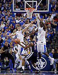 Junior guard Jarrod Polson and freshman forward Alex Poythress jump to block sophomore Raijon Kelly's shot during the second half of the Men's Basketball game vs. Samford at the Rupp Arena in Lexington, Ky., on Tuesday, December 4th, 2012..