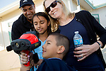 A family checks out an infared scanner used by the Santa Clara County Fire Department during a National Night Out celebration at Montclaire Elementary School in Los Altos August 6.