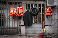 February 17, 2016: Life vests hang up in one commercial street in Aksaray, a neighbourhood located in the Fatih district of Istanbul. The area has turned into the gathering point for thousands of Syrian refugees that had fled from the war-torn Syria, also the neighbourhood is the one of the main destinations along the smuggling route for the refugees and migrants on their way to Europe.