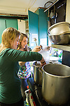 MLK day of service volunteers Gabby Clarke and Kristen Hencsei cook pasta in preparation for the United Campus Ministries lunch.