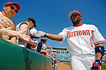 8 March 2006: Marlon Anderson, infielder for the Washington Nationals, hands a fan an autographed baseball  prior to a Spring Training game against the St. Louis Cardinals. The Cardinals defeated the Nationals 7-4 in 10 innings at Space Coast Stadium, in Viera, Florida...Mandatory Photo Credit: Ed Wolfstein.