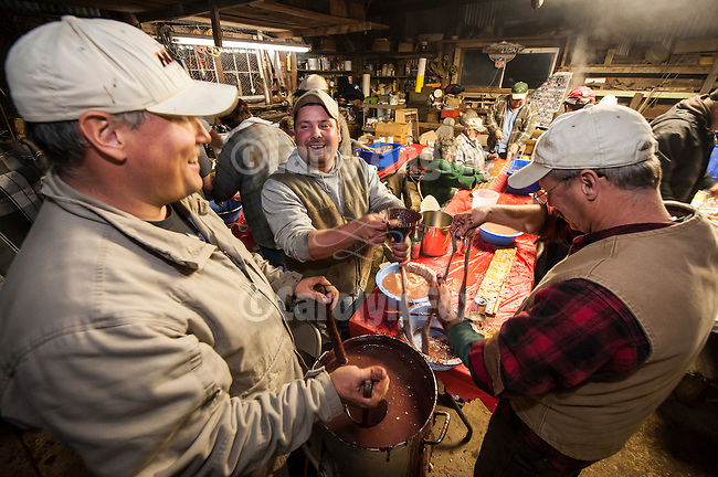 Filling the sausage casings is a social occasion during the in making blood sausage (brodies) during the annual hog slaughter and blood sausage making at the Cuneo Ranch, Clinton, Calif.