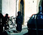 Woman walking along a narrow road in Cassablanca,Morocco