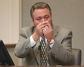 William Green, a ballistics expert from the Prince George's County Maryland Police Department, gestures during his testimony in the trial of sniper suspect John Allen Muhammad in courtroom 10 at the Virginia Beach Circuit Court in Virginia Beach, Virginia on October 31, 2003.<br /> Credit: Adrin Snider - Pool via CNP