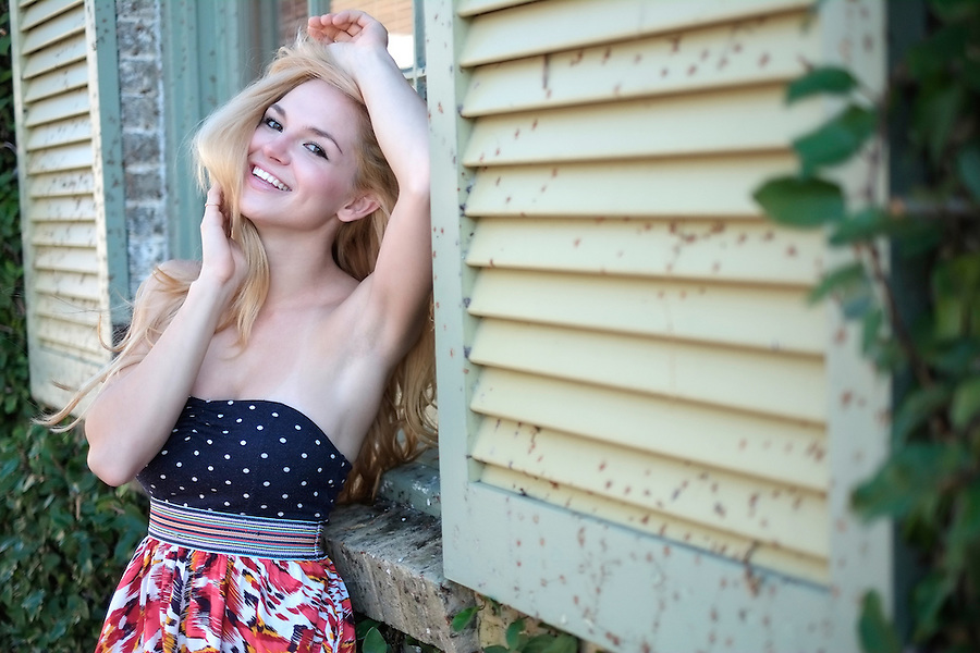 Portrait of a caucasian woman very happy resting in a window