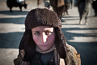 A Wakhi boy with green eyes..Leaving Sarhad village (end of the road in the Wakhan Corridor), to trek up to the Little Pamir with yak caravan over the frozen Wakhan river.