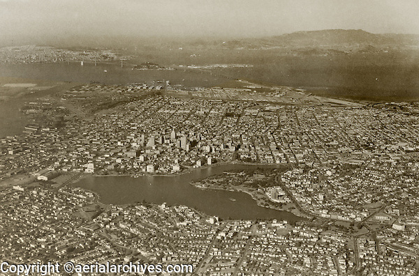 historical aerial photograph of Lake Merritt and downtown Oakland, California,with San Francisco and the Golden Gate bridge in the background, 1938