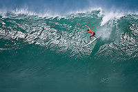 """WAIMEA BAY, Oahu/Hawaii (Tuesday, December 8, 2009) -Andy Irons (HAW)  The Quiksilver In Memory of Eddie Aikau,  was officially  called """"ON"""" by Contest Director George Downing this morning. The ASP specialty sanctioned event kicked off at 8am with wave face heights in the 25-35-foot range..Nine times world champion Kelly Slater (USA) led for most of the day until Greg Long(USA) scored his best four scoring rides in the last heat of the day to over take Slater. Long scored a perfect 100 point wave late in the day to seal the first prize purse of $55,000. Slater was runner up with Sunny Garcia (HAW) in 3rd, defending champion Bruce Irons (HAW) 4th and Ramon Navarro (CHL)  in 5th place. Navarro won the Monster drop award for the biggest drop, also in the final heat of the day when wave faces were pushing 40' plus...The northern hemisphere winter months on the North Shore signal a concentration of surfing activity with some of the best surfers in the world taking advantage of swells originating in the stormy Northern Pacific. Notable North Shore spots include Waimea Bay, Off The Wall, Backdoor, Log Cabins, Rockpiles and Sunset Beach... Ehukai Beach is more  commonly known as Pipeline and is the most notable surfing spot on the North Shore. It is considered a prime spot for competitions due to its close proximity to the beach, giving spectators, judges, and photographers a great view...The North Shore is considered to be one the surfing world's must see locations and every December hosts three competitions, which make up the Triple Crown of Surfing. The three men's competitions are the Reef Hawaiian Pro at Haleiwa, the O'Neill World Cup of Surfing at Sunset Beach, and the Billabong Pipeline Masters. The three women's competitions are the Reef Hawaiian Pro at Haleiwa, the Gidget Pro at Sunset Beach, and the Billabong Pro on the neighboring island of Maui...Photo: Joliphotos.com"""