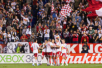 New York Red Bulls players celebrate a goal. The New York Red Bulls defeated Toronto FC 4-1 during a Major League Soccer (MLS) match at Red Bull Arena in Harrison, NJ, on September 29, 2012.