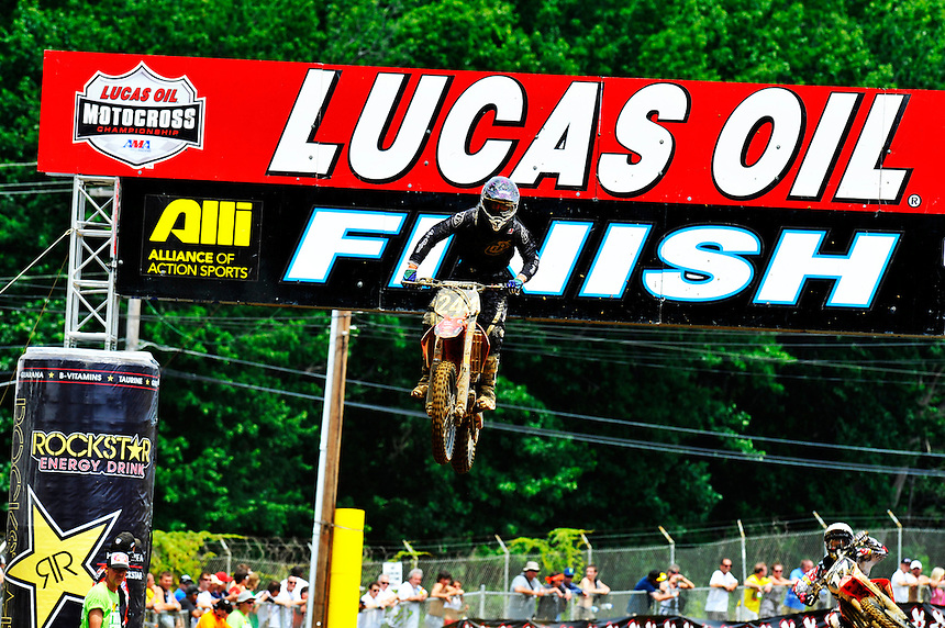 Ryan Zimmer goes up the Lucas Oil banner during the first moto of the 250 class at the Lucas Oil AMA Pro Motocross at Budds Creek National in Mechanicsville, Maryland on Saturday, June 18, 2011. Alan P. Santos/DC Sports Box