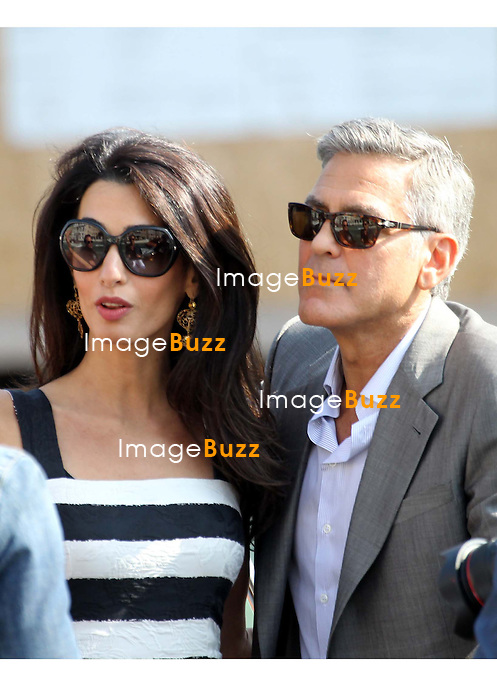 GEORGE CLOONEY &amp; AMAL ALAMUDDIN ARRIVE IN VENICE FOR THE WEDDING - <br /> George Clooney &amp; British fiancee Amal Alamuddin arriving in Venice with guests, prior to their wedding day. <br /> The couple and their guests took a taxi boat called 'Amore'.<br /> Robert De Niro, Matt Damon, Brad Pitt and Cate Blanchett were among the other stars, like Cindy Crawford, Rande Gerber, Bill Murray, Emily Blunt.<br /> Italy, Venice, 26 September, 2014.