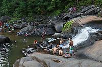 People in the pool of Seven Wells waterfalls, Langkawi, Malaysia