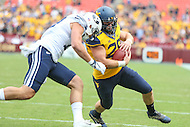 Landover, MD - September 24, 2016: West Virginia Mountaineers tight end Elijah Wellman (28) gets tackled by a BYU Cougars defender during game between BYU and WVA at  FedEx Field in Landover, MD.  (Photo by Elliott Brown/Media Images International)