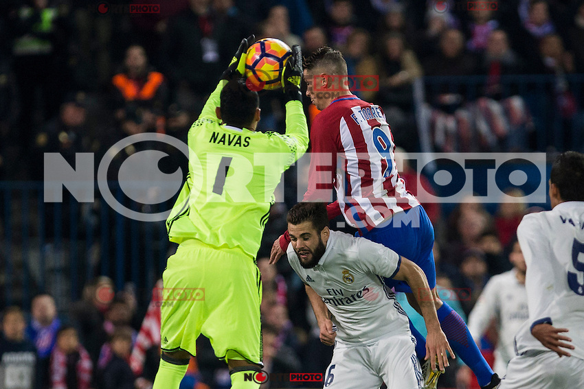 Real Madrid's Keylor Navas Raphael Varane Atletico de Madrid's Fernando Torres during the match of La Liga between Atletico de Madrid and Real Madrid at Vicente Calderon Stadium  in Madrid , Spain. November 19, 2016. (ALTERPHOTOS/Rodrigo Jimenez) /NORTEPHOTO.COM