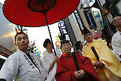 Religious leaders from local temple stand in the Ameyokocho market street during a local festival, Near Ueno, Tokyo, Japan.