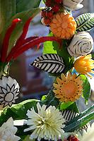Arrangement of vegetables sculpted into flowers