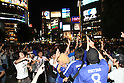 June 19, 2010 - Tokyo, Japan - Japanese supporters cheer during the 2010 World Cup football match Netherlands vs Japan on June 19, 2010 at Shibuya district, Tokyo, Japan. The Netherlands defeated Japan 1-0.