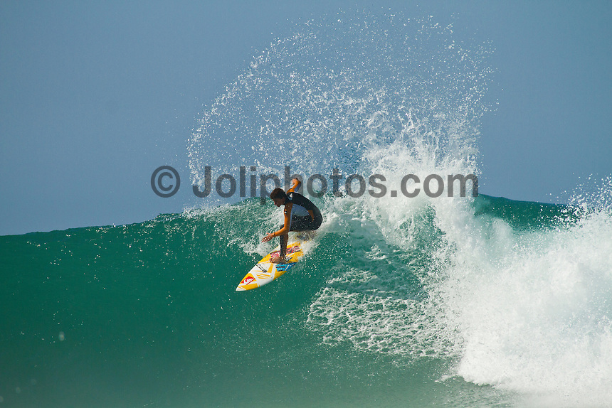 Monday July 26, 2010. Maxime Huscenot (REU) free surfing at Supertubes, Jeffreys Bay, Eastern Cape, South Africa.  Photo: joliphotos.com