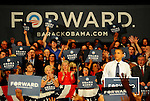LAURA FONG | SUMMER KENT STATER Obama supporters hold up four fingers and chant 'FOUR MORE YEARS!!' at the John S. Knight Center Wednesday.