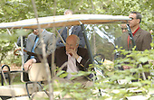 United States Vice President Dick Cheney watches from a golf cart as U.S. President George W. Bush and President Hosni Mubarak of Egypt answer reporters questions on the Middle East at Camp David, Maryland on Saturday, June 8, 2002..Credit: Greg E. Mathieson - Pool via CNP