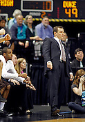 Lehigh head coach Murray Goodman watches a tense play. Lehigh defeated Duke 75-70 during the 2nd round of the 2012 NCAA Basketball Championship at the Greensboro Coliseum in Greensboro, NC. Photo by Al Drago.