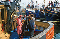 Princess Anne on a May 1985 Royal Visit to N Ireland meets the crew of Willing Lad, a fishing boat in the harbour at Portavogie, Co Down, N Ireland. The crews of other fishing boats get a grandstand view of the visit. Princess Anne had just officially re-opened the harbour after extensive improvements. 19850502f..Copyright Image from Victor Patterson, 54 Dorchester Park, Belfast, UK, BT9 6RJ..Tel: +44 28 9066 1296.Mob: +44 7802 353836.Voicemail +44 20 8816 7153.Skype: victorpattersonbelfast.Email: victorpatterson@me.com.Email: victorpatterson@ireland.com (back-up)..IMPORTANT: If you wish to use this image or any other of my images please go to www.victorpatterson.com and click on the Terms & Conditions. Then contact me by email or phone with the reference number(s) of the image(s) concerned.