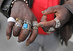 A man shares his ring collection to the photographer