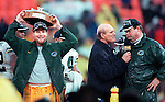 (1998)-Green Bay's Brett Favre celebrates winning the NFC Championship with a win over the San Francisco 49er's.