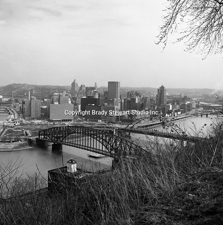 Pittsburgh PA:  Views of the city from Mount Washington - 1962.  Point Bridge in foreground with the new Fort Pitt Bridge behind it.