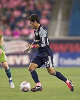 New England Revolution midfielder Benny Feilhaber (22) at midfield. In a Major League Soccer (MLS) match, the Seattle Sounders FC defeated the New England Revolution, 2-1, at Gillette Stadium on October 1, 2011.